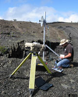 Kevan Kamibayashi, USGS, tests the network link between the SO2 camera system at Kilauea's summit caldera and the Hawaiian Volcano Observatory. Photo credit: Christoph Kern, USGS.