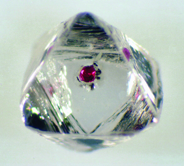 Diamond with garnet inclusion